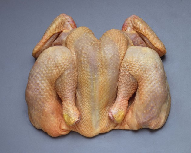Butterflied raw chicken