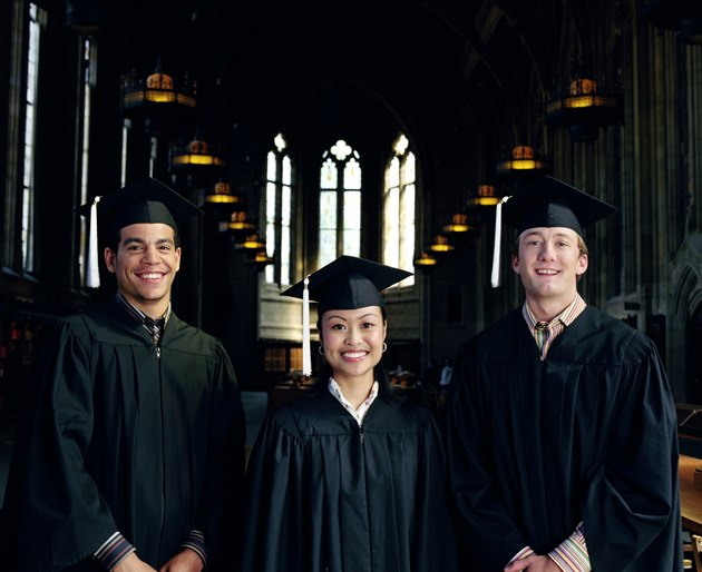 Group of graduates standing in library, portrait