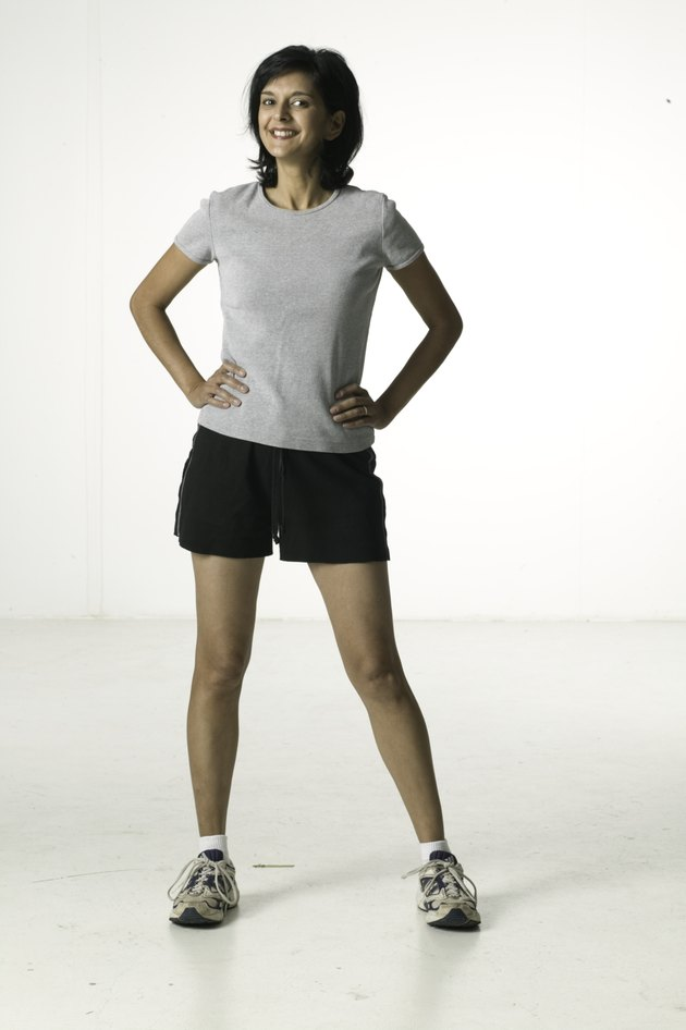 Young woman wearing sports clothing, posing in studio, portrait