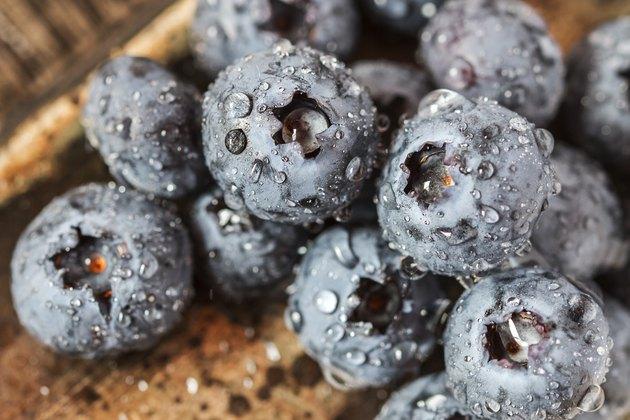 Wet fresh Blueberry on wooden background