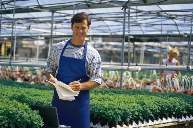 Nursery employee in greenhouse