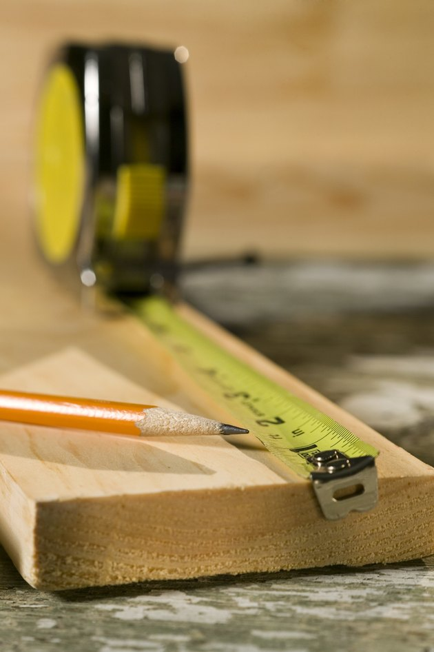 Tape measure, pencil, and wood