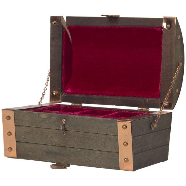 Open wood chest lined in velvet