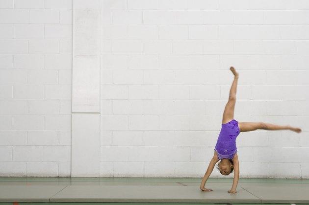 Gymnast girl doing cartwheel