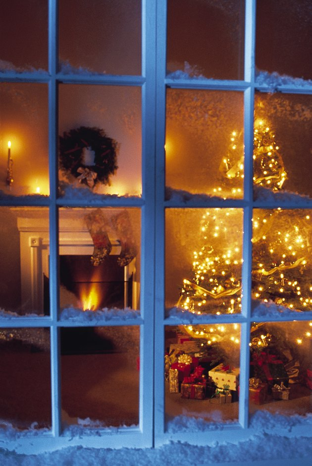 View through window of home decorated for Christmas