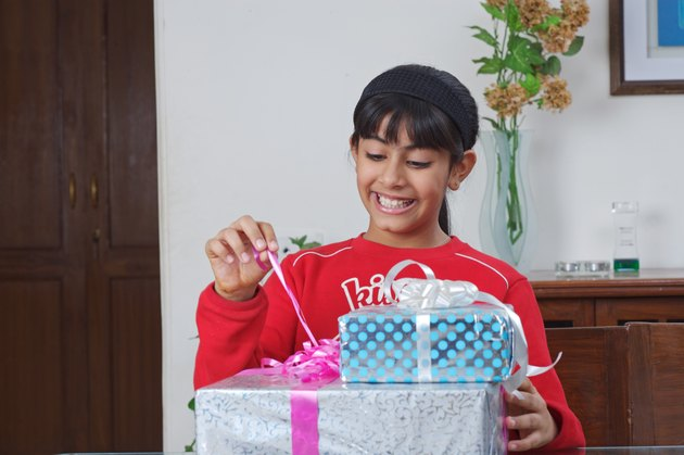 Girl opening a gift pack