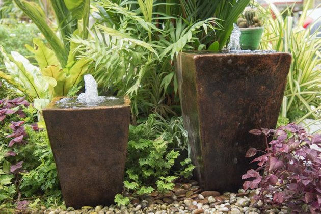 Water feature in garden is Chinese belief  fountain from pot put on right front of house is lucky.