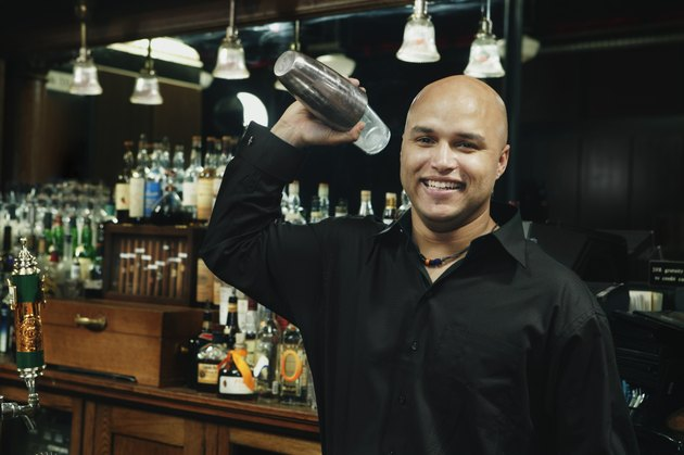 Bartender with cocktail shaker