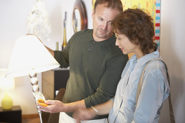 Mid adult couple looking at a lamp in a store