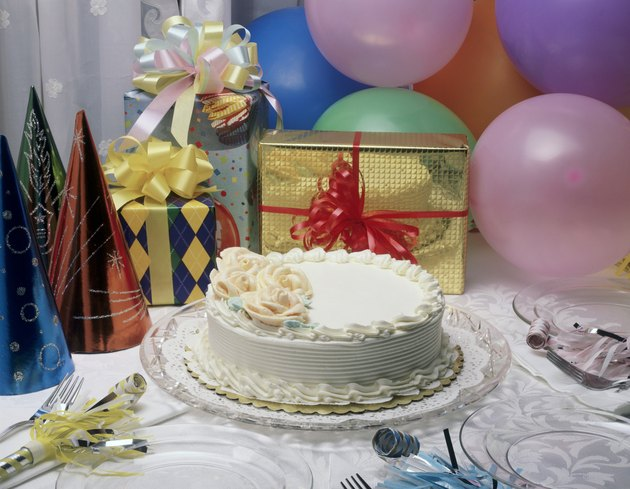 Close-up of a birthday cake and presents