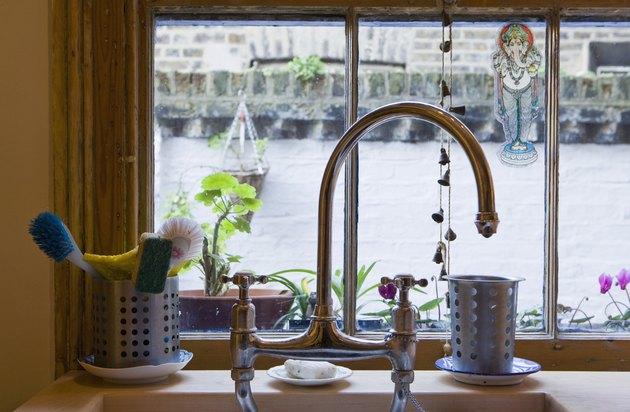 Kitchen sink with utensils