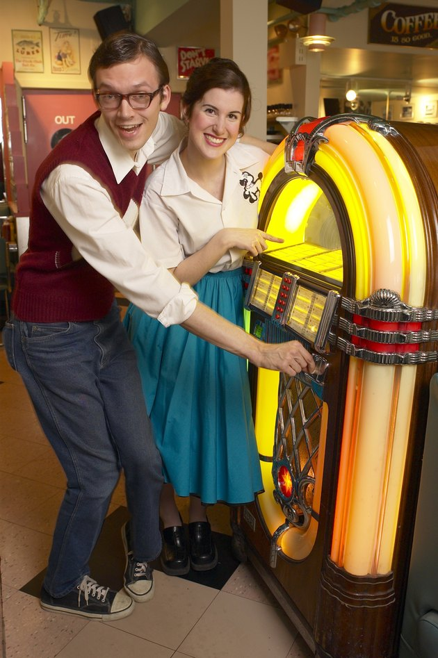Couple selecting song on jukebox