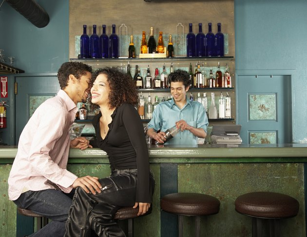 Young People Flirting in a Bar