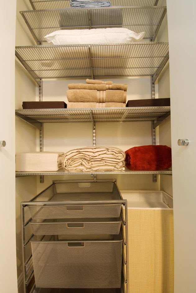 Towels arranged on shelves in household closet