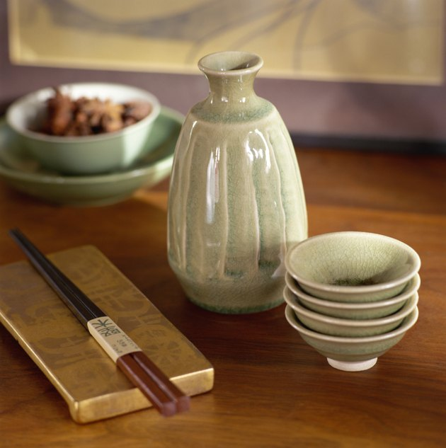 Chopsticks and soy sauce pitcher and bowls