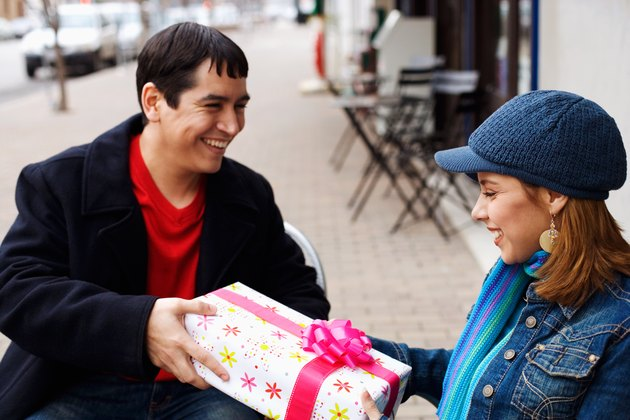 Man giving present to woman