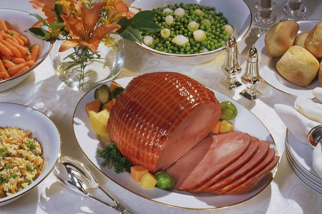 Table with baked ham and other dishes