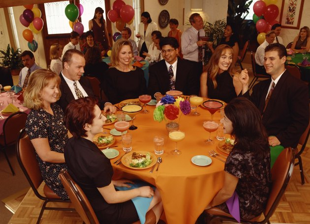 Businesspeople eating in banquet hall party