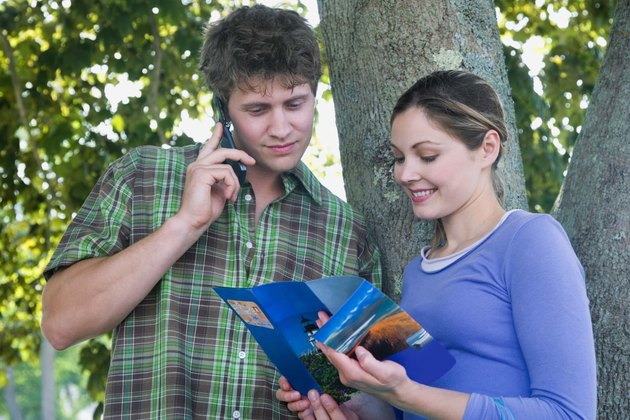 Couple looking at travel brochure