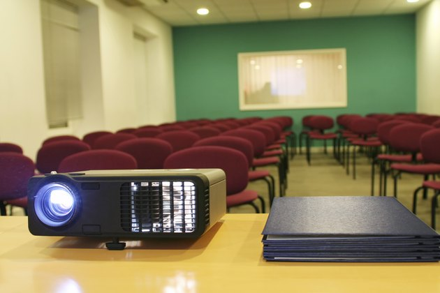 Projector on table with chairs behind (horizontal)