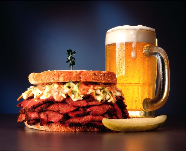 Pastrami sandwich with mug of beer
