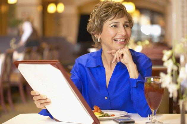 Woman with a menu at a restaurant