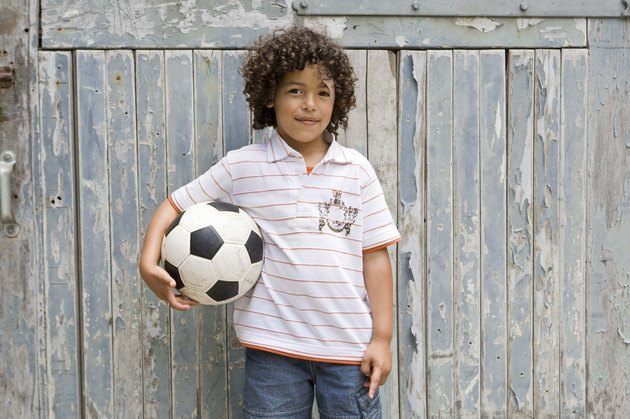 Portrait of boy with soccer ball