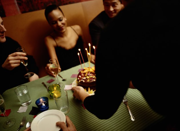 Woman Receiving a Cake at a Birthday Party