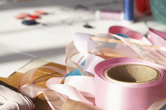 Rolls of ribbon on table, close-up