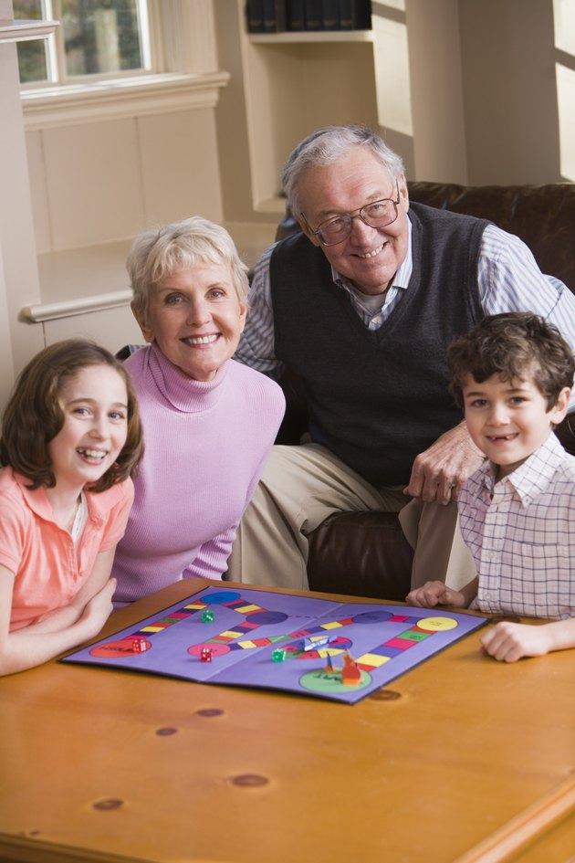 Grandparents playing game with grandchildren