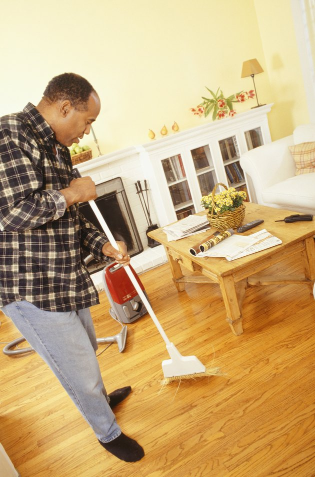 Man sweeping living room floor