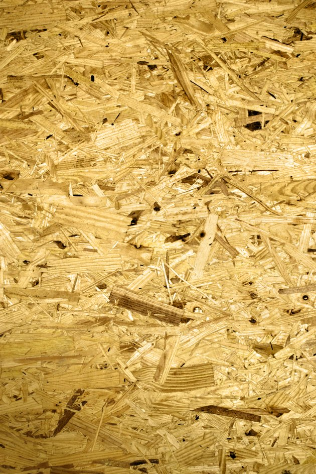 Close-up of texture of wooden particleboard.