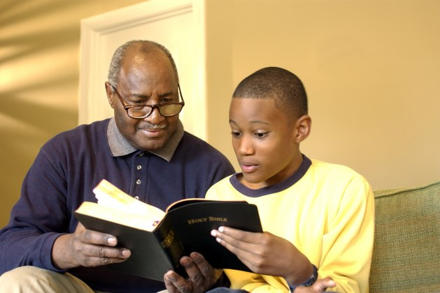 Grandfather and grandson reading the Bible