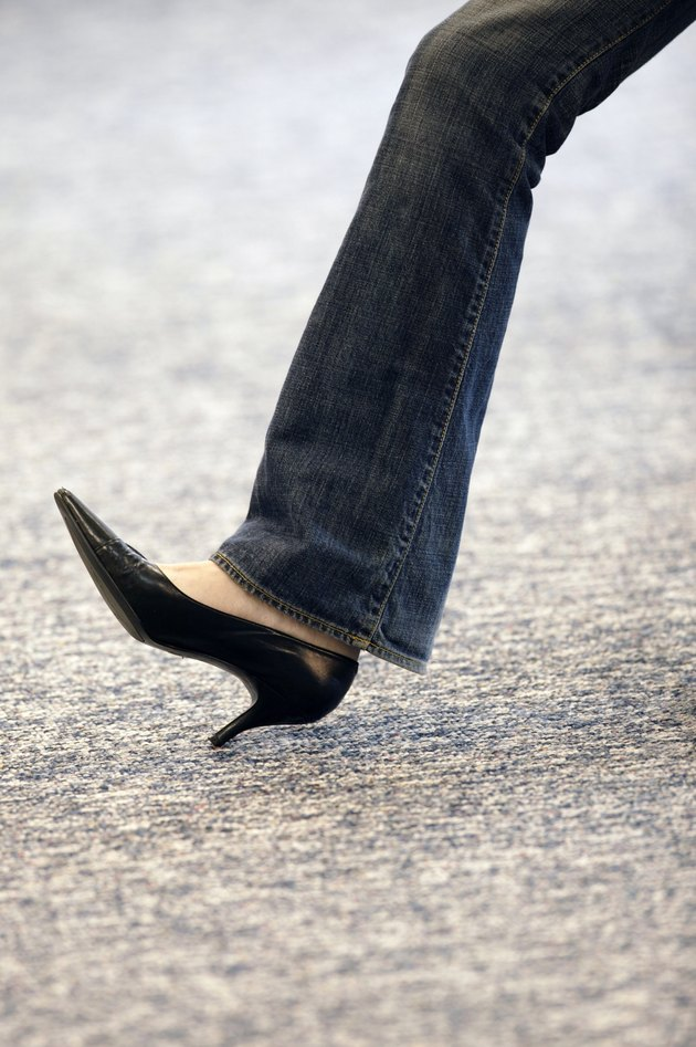 Leg of woman wearing high heels and jeans