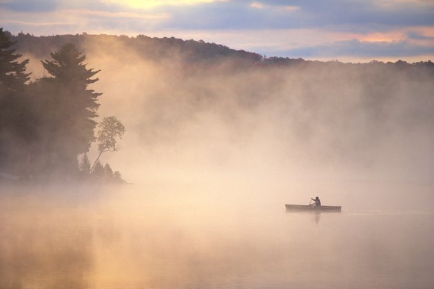 Canoe on a foggy lake