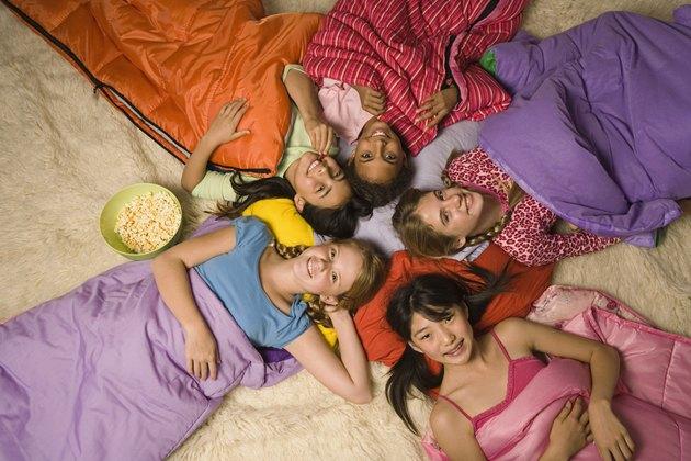 Group of preteen girls in sleeping bags