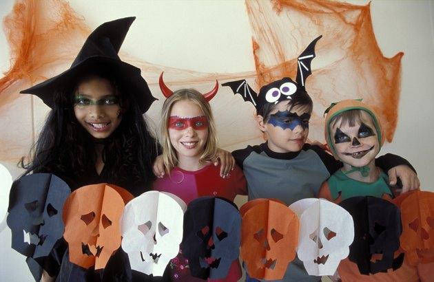 Portrait of children dressed up Halloween costumes