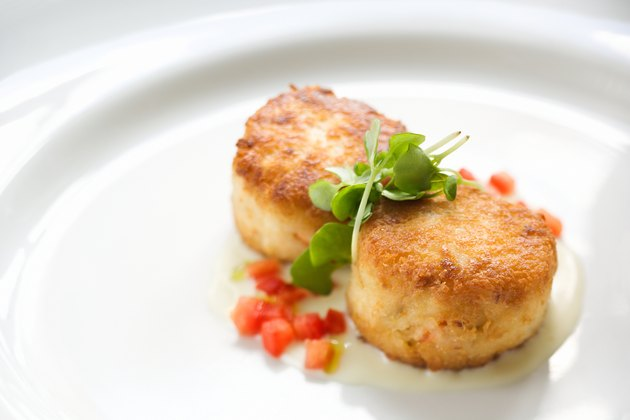 Crab cakes over a citrus beurre blanc