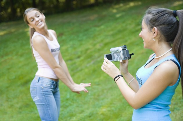 Teen girls with video camera