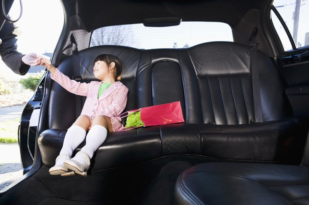 Girl sitting in limousine