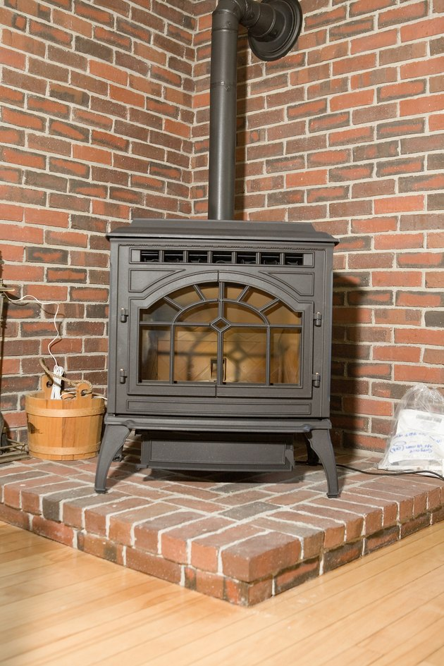 Wood stove in brick corner