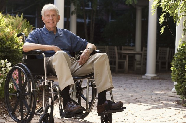 Elderly man in wheelchair outdoors