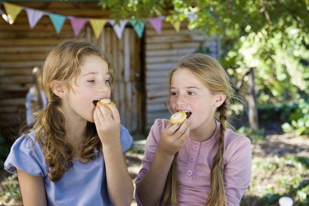 Girls eating cake