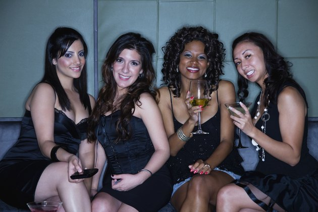 Women drinking cocktails in nightclub