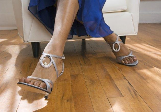 Woman's feet wearing high heel sandals
