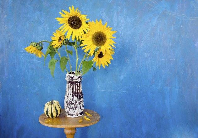 retro vase with sunflowers