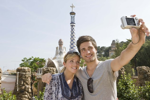 Smiling couple taking a picture, Barcelona, Spain