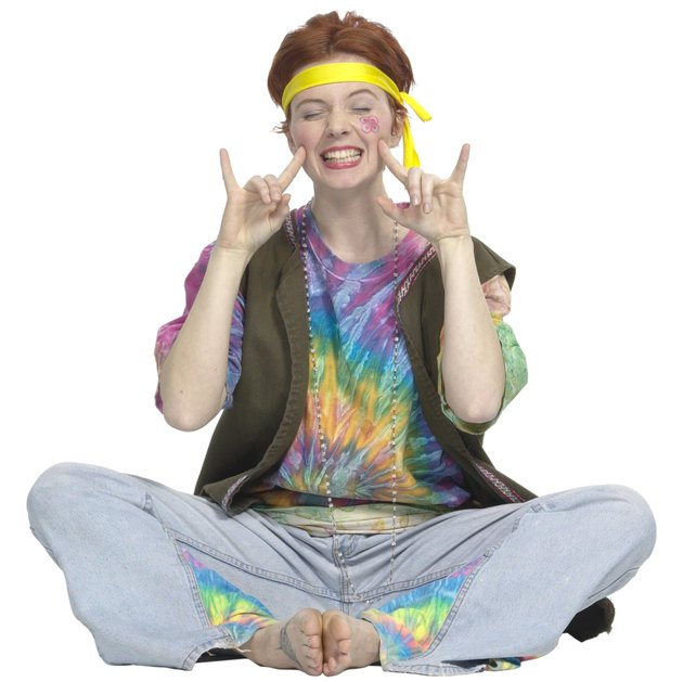 Girl giving peace sign in hippie clothing