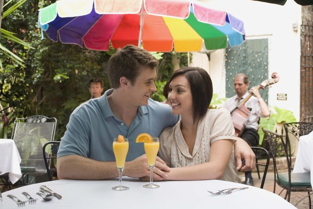 Couple at cafe with mimosas