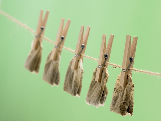 Clothes pins with tea bags on line